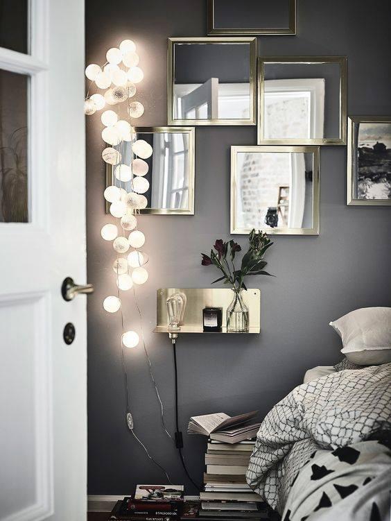 Lampki LED ciepłe na sznurze rozwieszone w sypialni